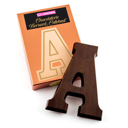 Dark chocolate letter A on top of it's Chocolaterie Bernard Callebaut®  box