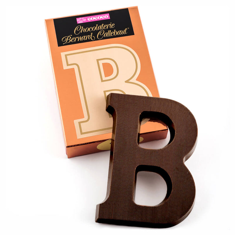 Dark chocolate letter B on top of it's Chocolaterie Bernard Callebaut®  box