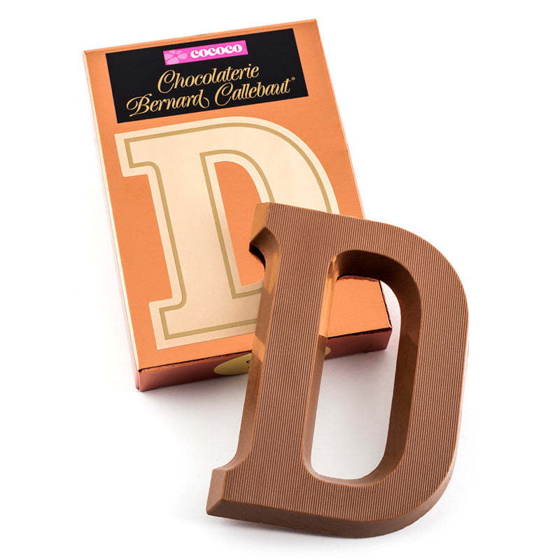 Milk chocolate letter D on top of it's Chocolaterie Bernard Callebaut®  box