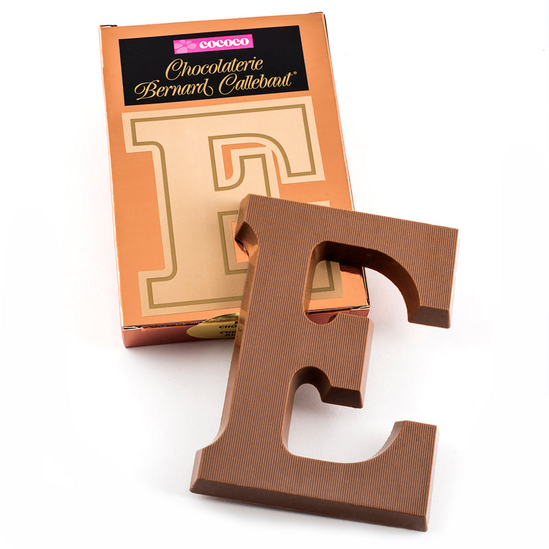 Milk chocolate letter E on top of it's Chocolaterie Bernard Callebaut®  box