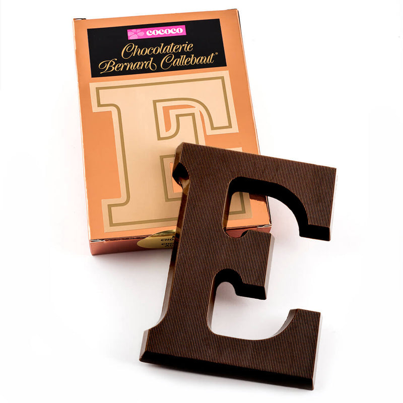 Dark chocolate letter E on top of it's Chocolaterie Bernard Callebaut®  box