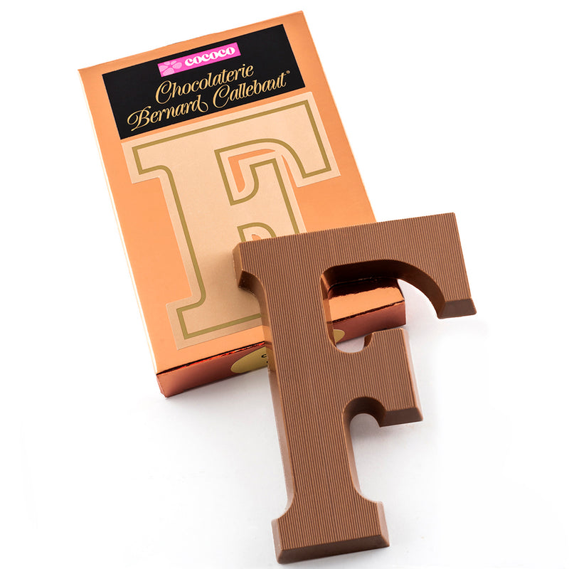 Milk chocolate letter F on top of it's Chocolaterie Bernard Callebaut®  box