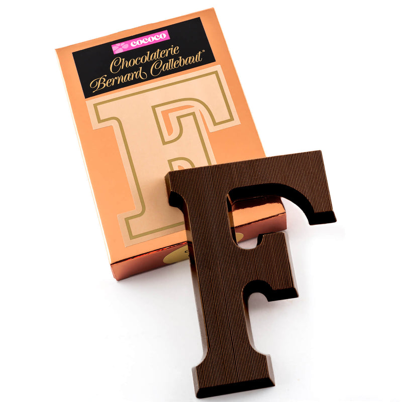 Dark chocolate letter F on top of it's Chocolaterie Bernard Callebaut®  box