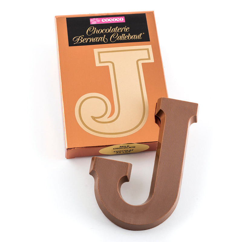 Milk chocolate letter J on top of it's Chocolaterie Bernard Callebaut®  box