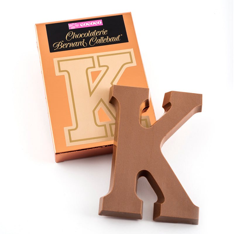 Milk chocolate letter K on top of it's Chocolaterie Bernard Callebaut®  box