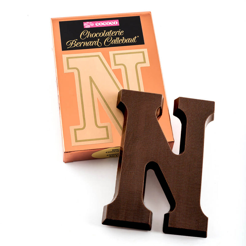 Dark chocolate letter N on top of it's Chocolaterie Bernard Callebaut®  box
