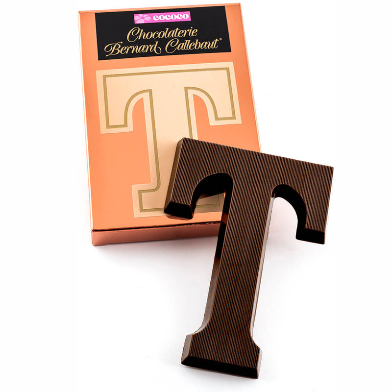 Dark chocolate letter T on top of it's Chocolaterie Bernard Callebaut®  box