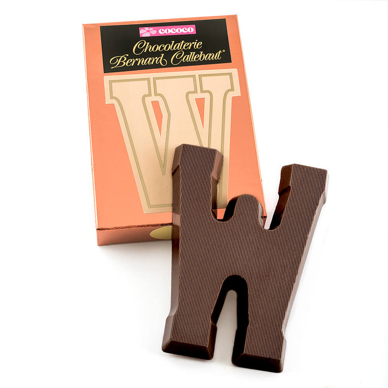 Dark chocolate letter W on top of it's Chocolaterie Bernard Callebaut®  box