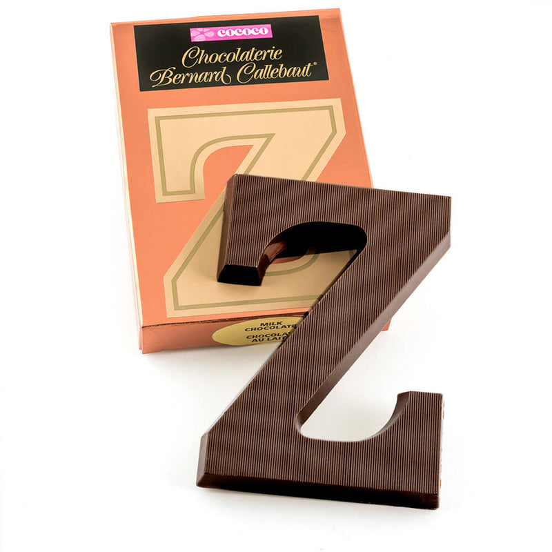 Dark chocolate letter Z on top of it's Chocolaterie Bernard Callebaut®  box