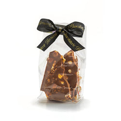 Cello bag of milk chocolate nut bag tied with Chocolaterie Bernard Callebaut® branded black ribbon