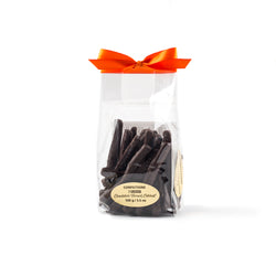 Cello bag with an orange ribbon of chocolate coated orange peel.