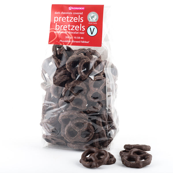 Bag of dark chocolate covered pretzels with a few pretzels in the foreground