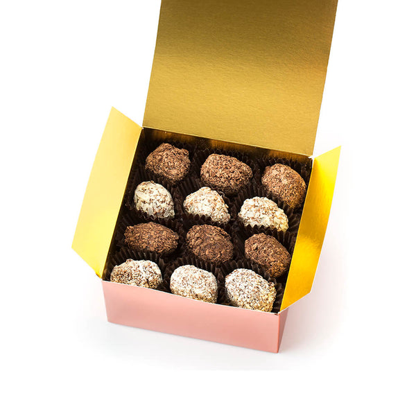 an open Chocolaterie Bernard Callebaut® copper box with 12 assorted truffles on top layer