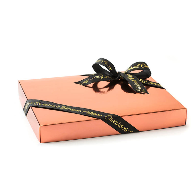 A Chocolaterie Bernard Callebaut® flat presentation box of chocolate with a black ribbon