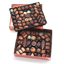 Top view of opened Chocolaterie Bernard Callebaut® flat presentation box of chocolate