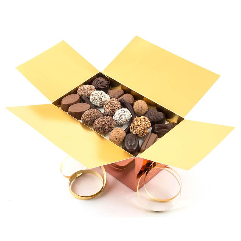 An opened Chocolaterie Bernard Callebaut® copper chocolate box with gold ribbon