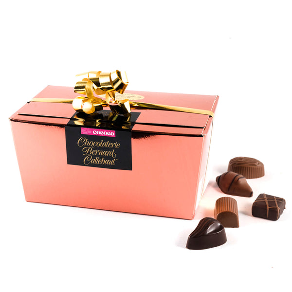 Chocolaterie Bernard Callebaut® copper chocolate box with gold ribbon and five chocolates next to box