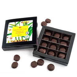 Opened box of dark chocolate coated candied ginger