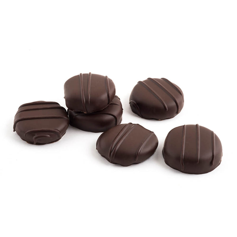 Six pieces of dark chocolate coated candied ginger