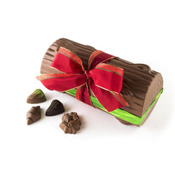 Milk chocolate Yule Log with red ribbon