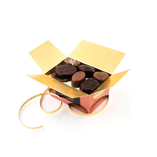 An opened Chocolaterie Bernard Callebaut® copper chocolate box