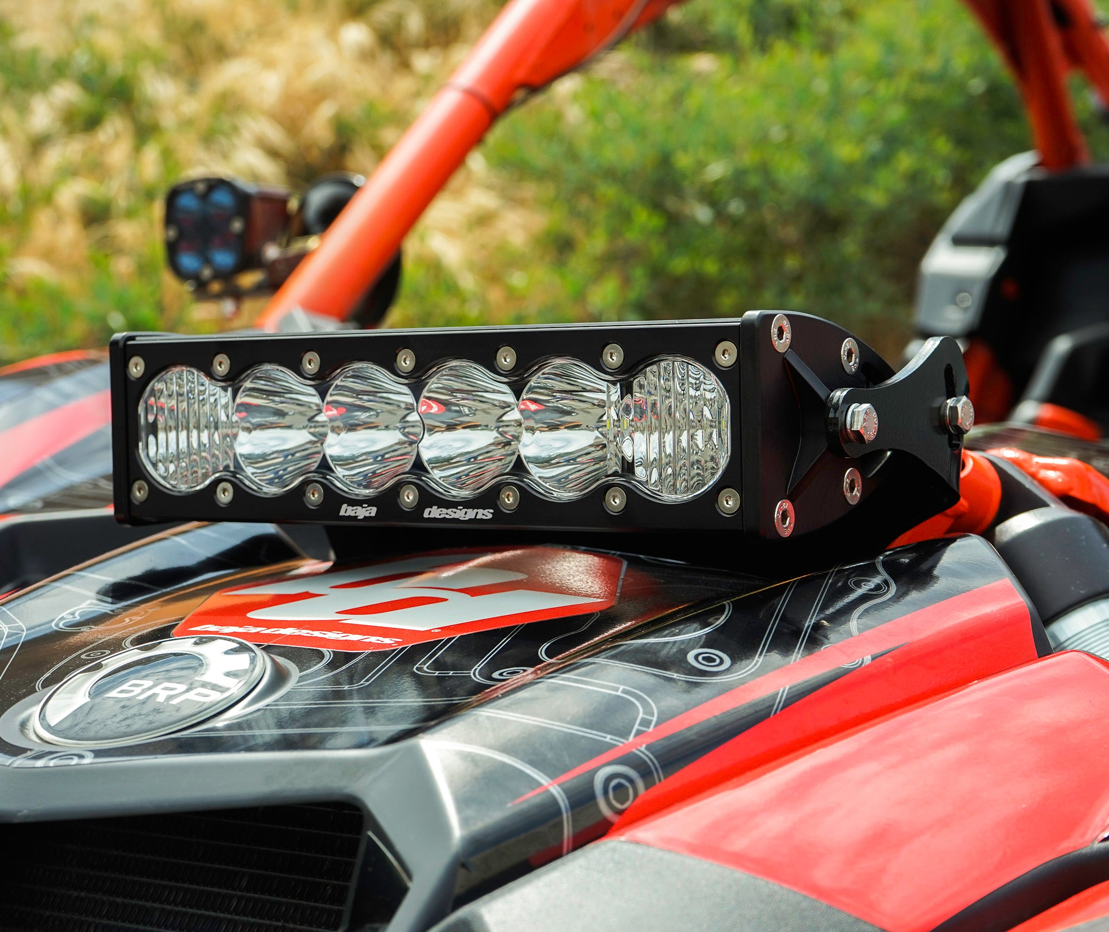 "Can-Am X3 OnX6+10"" Light Bar And Shock Mount Kit by Baja Designs Separate yourself from the pack with the Baja Designs Can-Am OnX6 Shock Mount. This kit includes a 10"" OnX6 light bar and mount that easily bolts up to the factory shock tower and keeps the light stable at high speeds. This kit is ideal for someone looking to gain forward projecting light while maintaining the X3's aggressive styling."