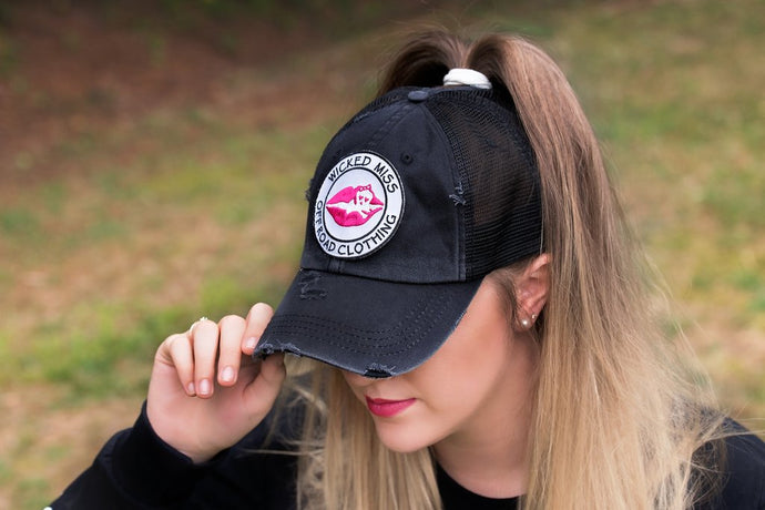 Women's Mesh Back Pony Cap with snapback for adjusting size. Holds Pony Tail in place.