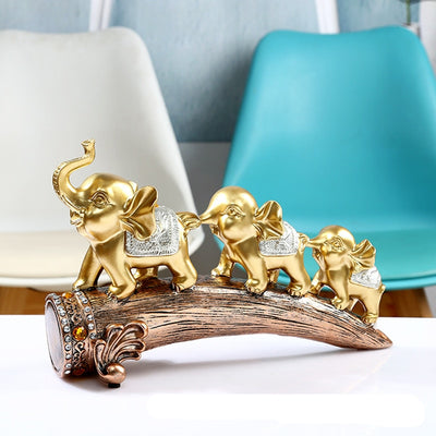 Three Gold Elephant Resin Statues