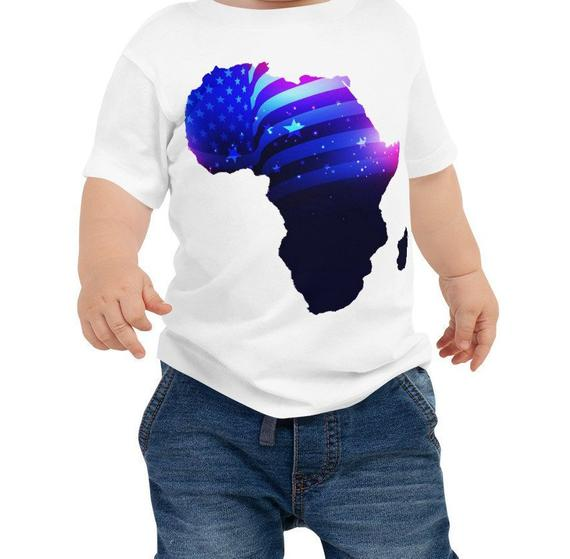 Baby wearing African American Baby Jersey T-shirt. A white shirt with an outline of Africa. Outline is filled in with a pic of the American Flag.