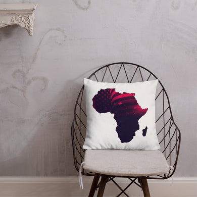Front of 18x18 African American Premium  Pillow. Has a white background with an outline of Africa. Outline is filled in with a pic of the American Flag in red.