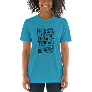 Woman wearing Aqua Triblend A Mother is a flower T-Shirt (Unisex) says A mother is a flower, each one is beautiful and unique.