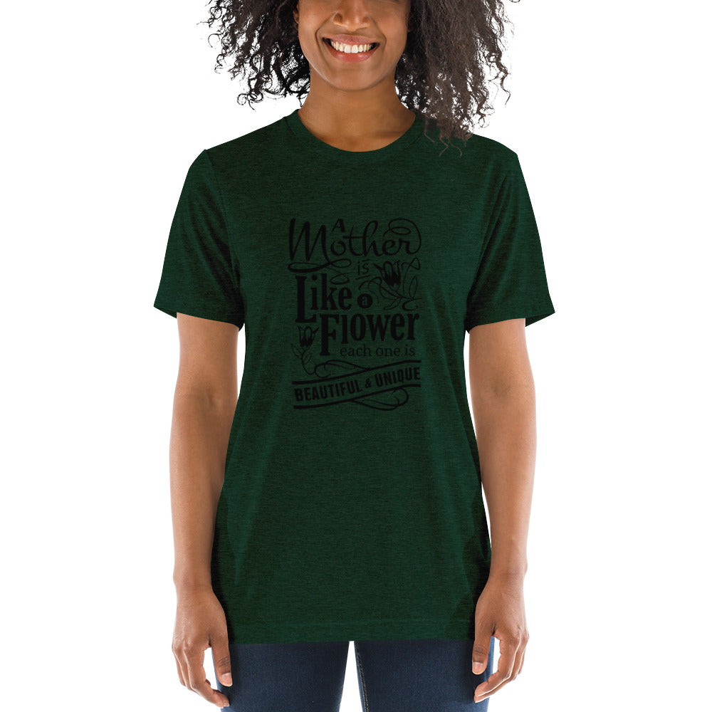 Woman wearing Emerald Triblend A Mother is a flower T-Shirt (Unisex) says A mother is a flower, each one is beautiful and unique.