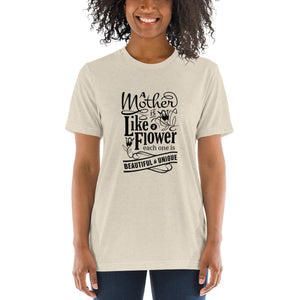 Woman wearing Oatmeal Triblend A Mother is a flower T-Shirt (Unisex) says A mother is a flower, each one is beautiful and unique.