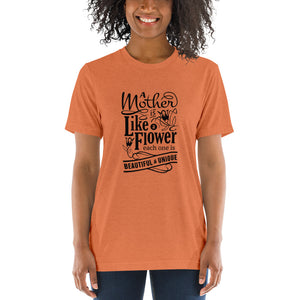 Woman wearing Orange Triblend A Mother is a flower T-Shirt (Unisex) says A mother is a flower, each one is beautiful and unique.
