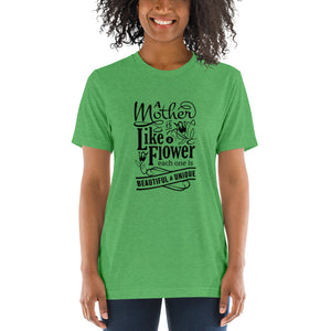 Woman wearing Green Triblend A Mother is a flower T-Shirt (Unisex) says A mother is a flower, each one is beautiful and unique.