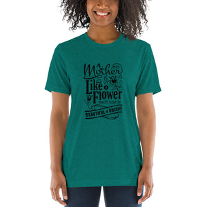 Woman wearing Teal Triblend A Mother is a flower T-Shirt (Unisex) says A mother is a flower, each one is beautiful and unique.
