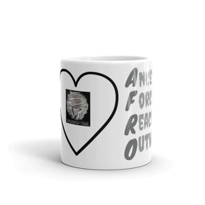 Front of 11oz Afro Acronym Coffee Mug. Has a heart with lady with an afro inside. Says Hellwig By Tikia and shows part of the side that says afro.