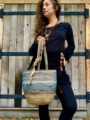 handmade rope basket with leather feather accent
