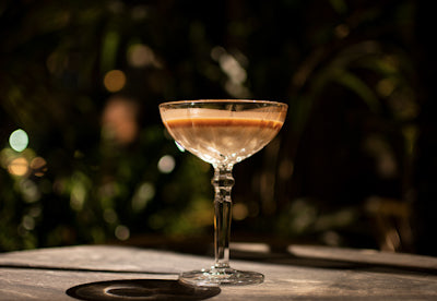 champagne_cocktail_in_flute_glass_peru_ginger_syrup_origin_botanical_nectar