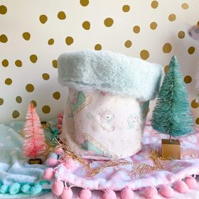 Small storage bin in pink unicorn with sleigh with mint seal
