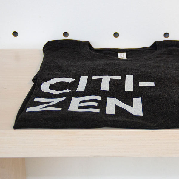 Citi-zen tshirt, folded on a bench.