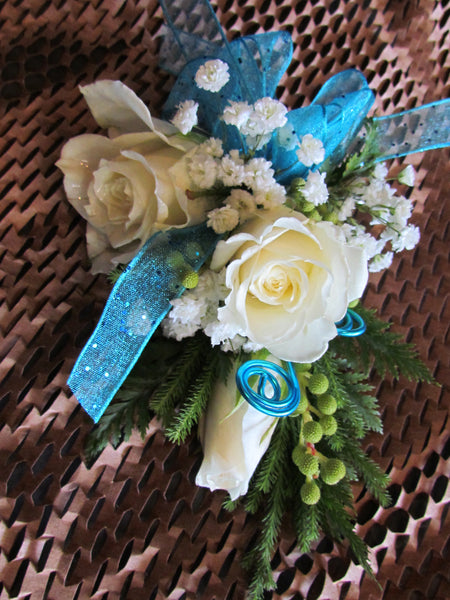 Corsage with rose, baby's breath, and ribbon