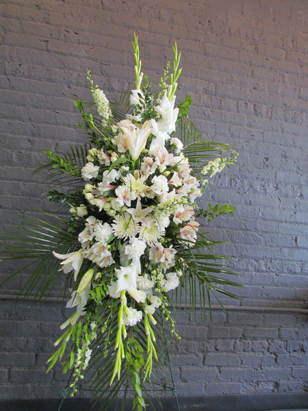 Funeral tribute spray in all white flowers