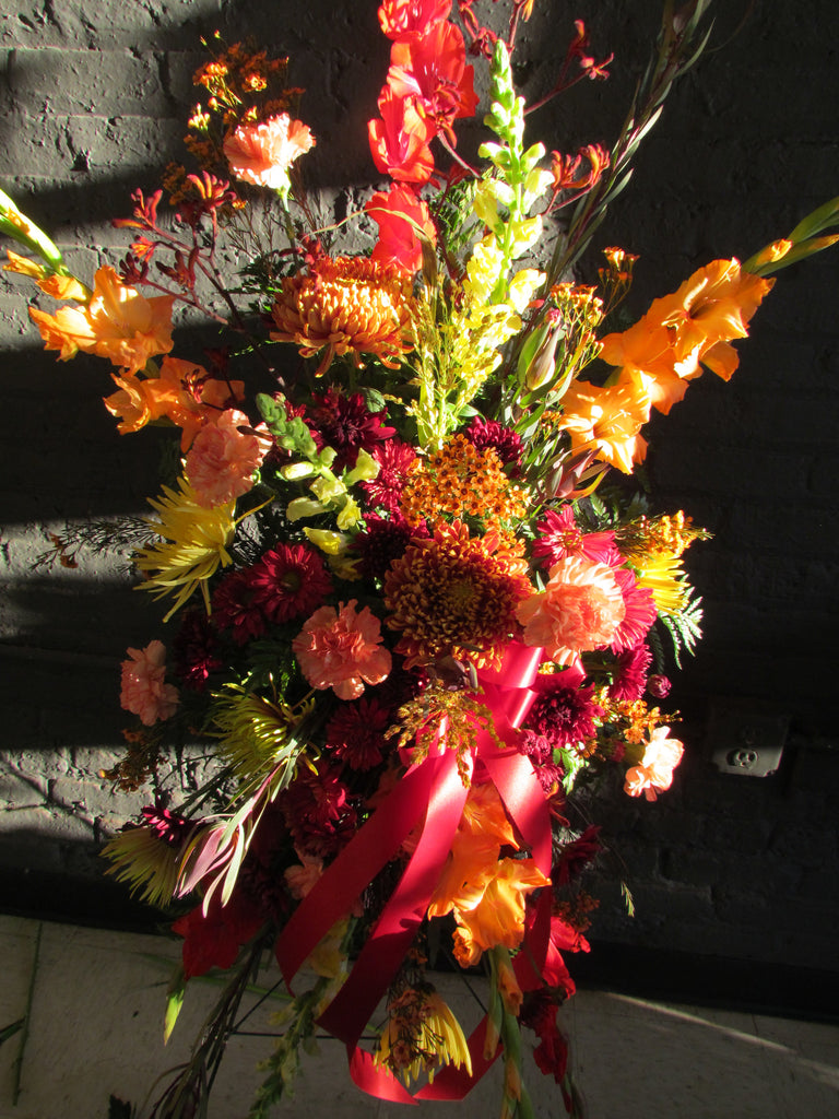 Fall colored casket spray with ribbon