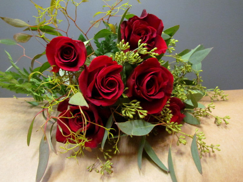 Half dozen red roses wrapped