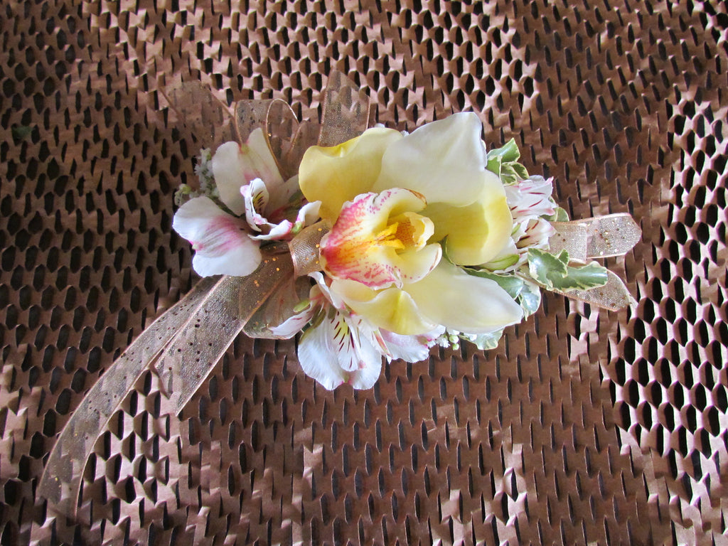 Orchid corsage with ribbon