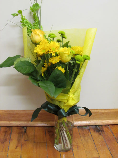 Green and yellow wrapped bouquet with ribbon