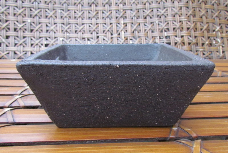 Earth square planters in peat