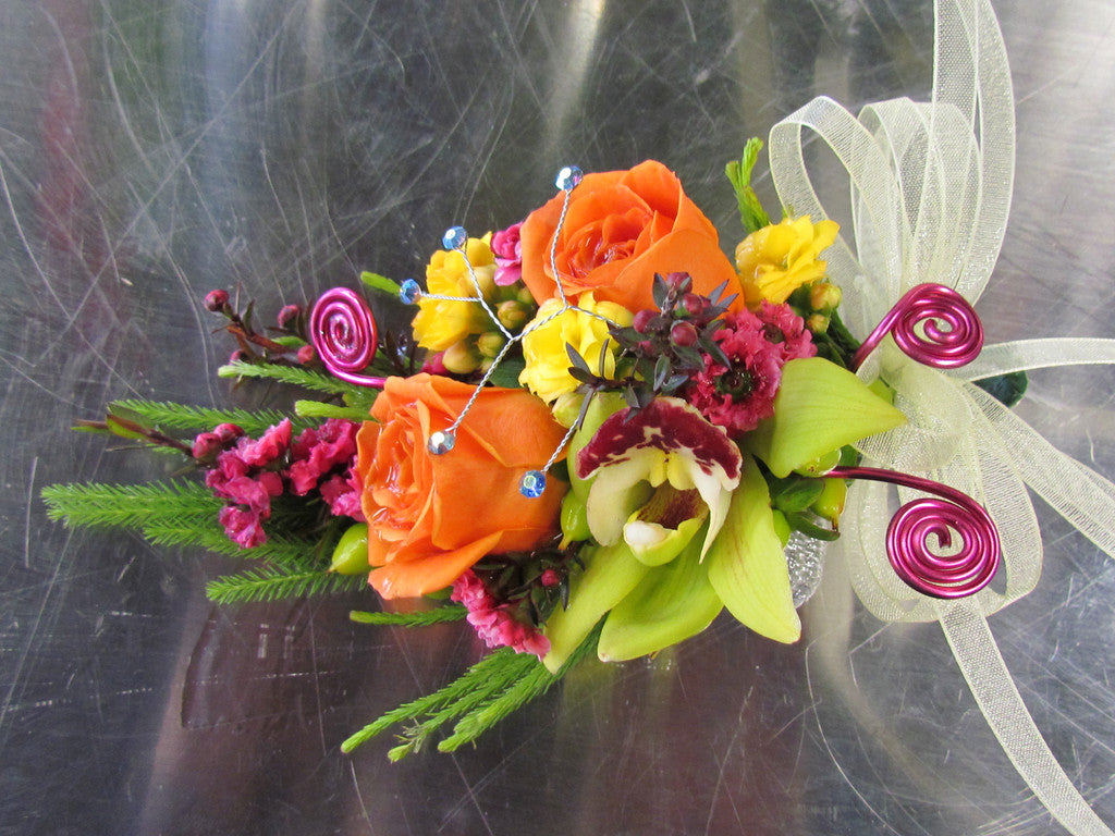 Dance corsage with specialty flowers, bling and ribbon