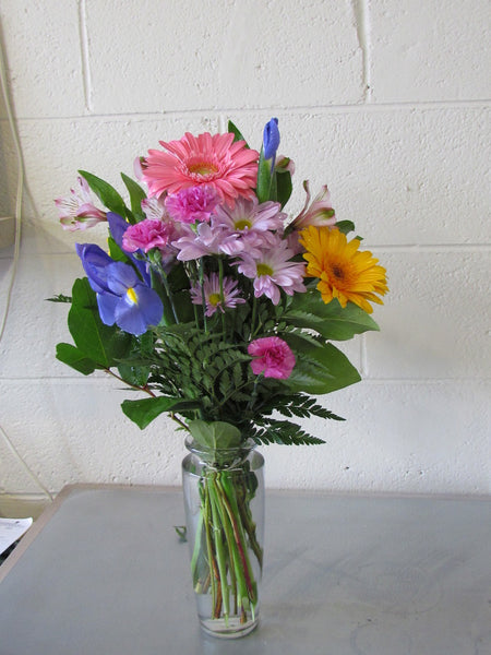 Fresh spring flower bouquet in glass vases